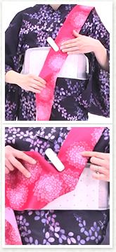 手先をクリップで帯板に仮止めし体の前で、タレ(胴に巻き付ける側の帯)を三角に広げます。